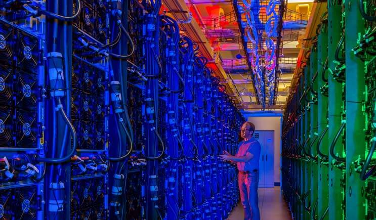 The colorful hot aisle of a high-density enclosure at the Microsoft data center in Boydton, Virginia, which has became a focal point of the company's cloud development. (Photo: Microsoft Corp.)