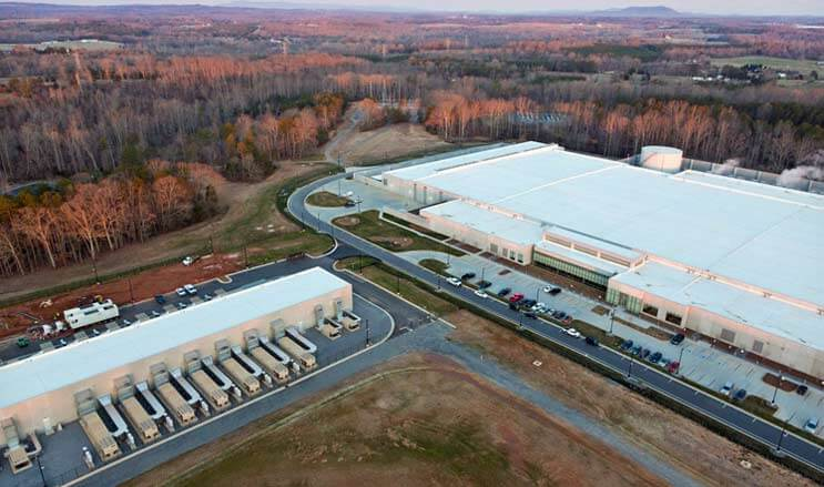 "The home of the iCloud: The Apple data center campus in Maiden, North Carolina, featuring a massive 500,000 square foot building (at right) supported by a smaller ""strategic"" data center using modular data center technology. (Photo: Apple)"