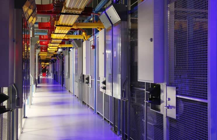 The distinctive blue-lit, cage-lined corridors inside the Equinix DC11 data center in Ashburn, Virginia. (Photo: Equinx)
